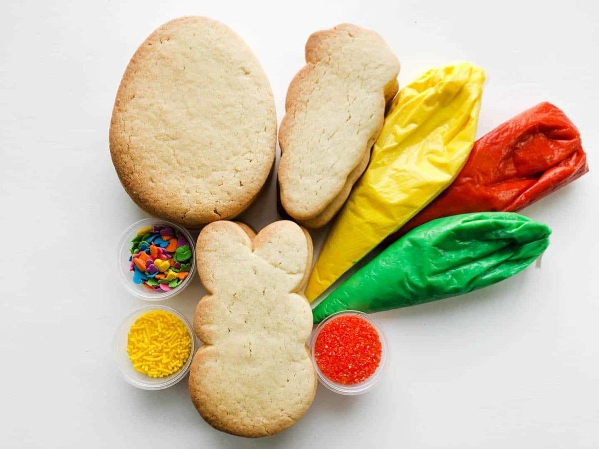 Easter DIY Packs. 12 cookies, 3 icings (Orange, Yellow, Green) 3 sprinkle sets